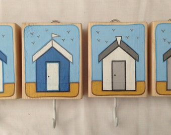 Set of 4 beach hut key hooks on timber