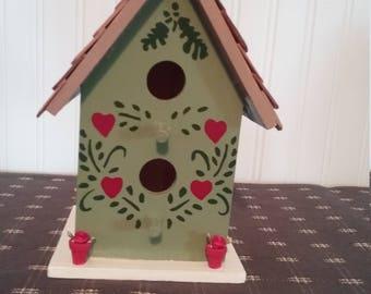 Green Birdhouse w/flowers in pots