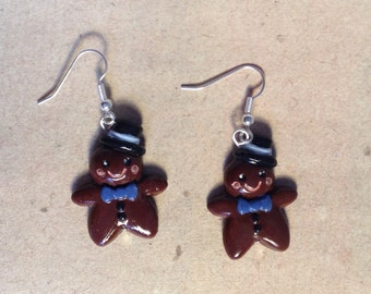 Earrings Gingerbread men dark-brown with blue bow