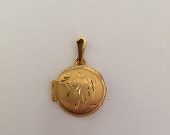 Round shaped locket (gold 18kt)