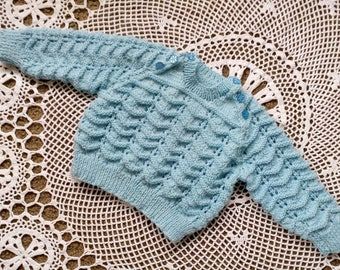 This lovely baby boy jumper will fit size nine to twelve months