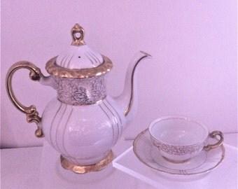 Vintage White Porcelain Tea Pot Tea Cup And Saucer
