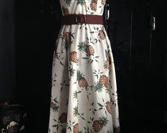 A 1950's style halter neck, full skirted dress.