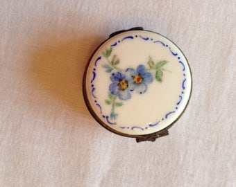 Blue flowers on a tiny Limoges type box.