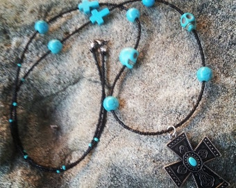 black and turquoise necklace with cross pendant