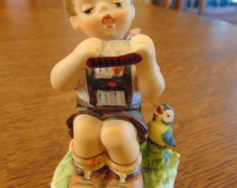 Hummel Figurine of Boy Playing Harmonica with Bird (free Shipping)