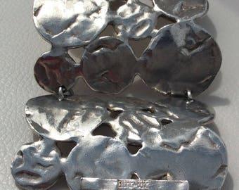 "Silver Metal Parisian  ""Biche de Bere"" Bracelet with Toggle Clasp."
