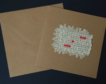 """Card mailing collage of text lines woven paper - crossword - """"the key to success"""""""