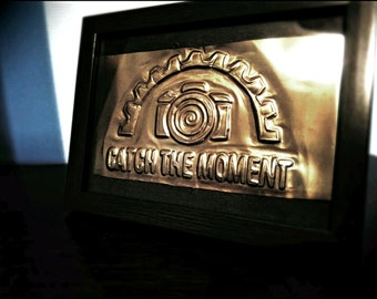 Handmade Embossed camera. Catch The Moment embossing made from a soda can.