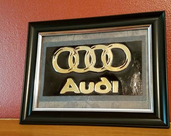 Handmade Embossed Audi logo made from a recycled soda can.