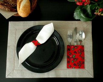 One natural linen table mat with pocket for cutlery. Original table mat with folk design