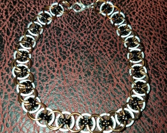 Chainmail jewelry bracelet.  Bronze and frost helm weave.