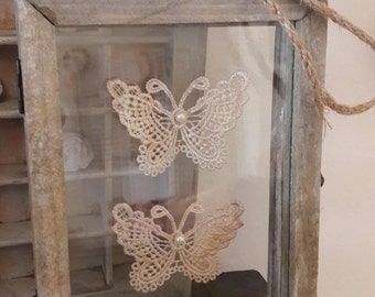 Vintage photo frame with glass and butterflies