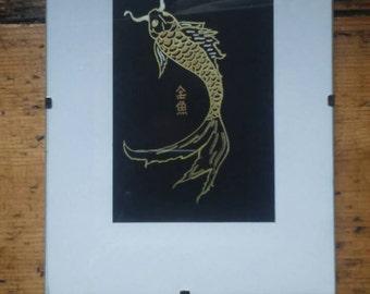 Goldfish on black paper; silver/two tone gold on black paper, kanji.