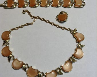 Vintage signed Coro demi parure jewelry set in gold tone and caramel color, necklace, bracelet, one earring.