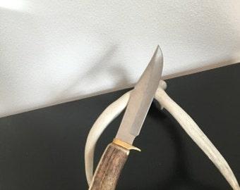 Large antler handle knife.
