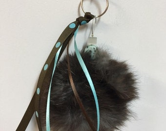 Door key or turquoise charm