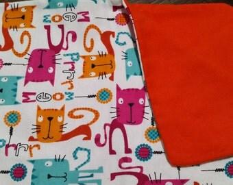 Cats with orange backing catnip blanket