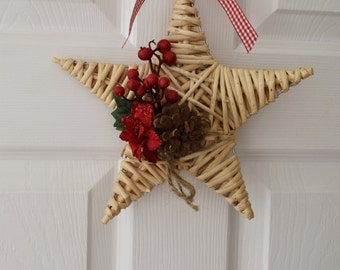 Wicker Star Natural with Poinsettia, Red Berries and Cone