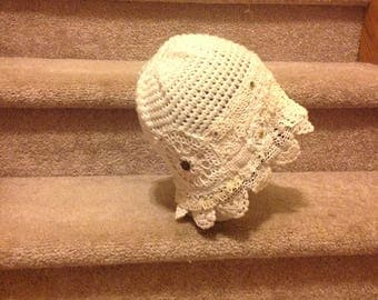 this is a vintage hat with buttons and crochet