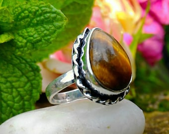 Gorgeous genuine Tiger's eye protection ring.