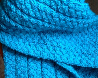 Knitted light blue scarf. Reversible