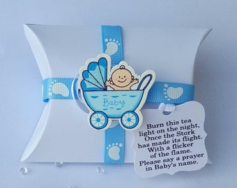 Baby shower pillow box favours  with scented tealight candle and chocolate.