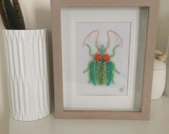 Embroidery insect Haute Couture in frame