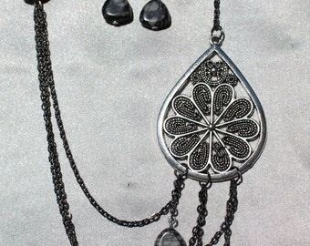 Serendipity:  Multi Black Chain Asymmertical Necklace And Earring Set Accented With Decorative Medallion