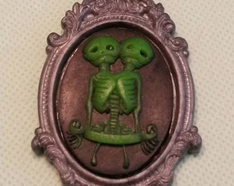 Conjoined twins cameo in ornate gray frame- alien twins- resin pendant