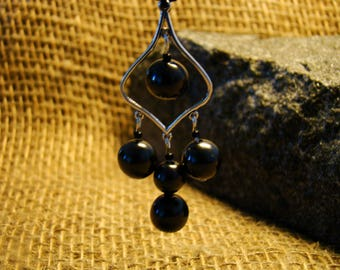 Shungite metal pendant with shungite beads from Karelia.