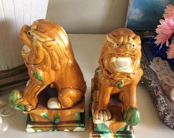 Vintage gold green and blue chinoiserie Foo Dogs on square base  pair