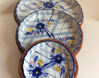 Mid century ceramic pie plate with wicker basket. Hand painted pie plate with ruffled edge. Hand painted blue daisies.
