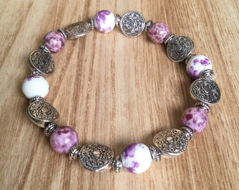 Beaded stretch bracelet with purple and silver beads