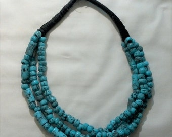 Boho, turquoise beaded, mid length, three stranded necklace