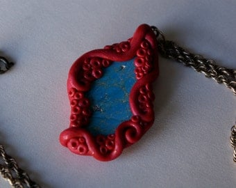 Turquoise wrapped in magenta tentacle necklace