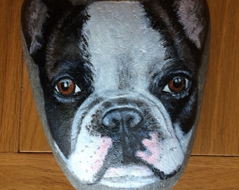 Hand painted black and white French bulldog dog on a large pebble