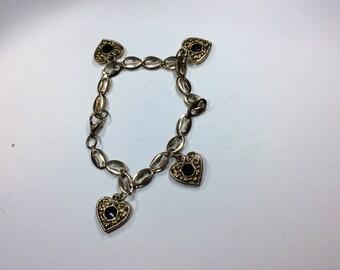Goldtone Heart Onyx Charm Bracelet