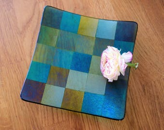 Iridescent glass dish in shades of green 15cm square.