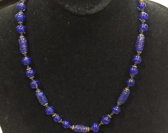Blue necklace with gold flakes infused