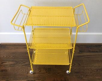 Vintage metal cart with casters