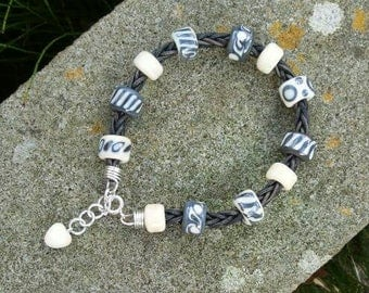 Lampwork bead bracelet on antique leather with sterling silver clasp and heart charm