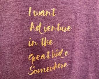 Belle's Adventure purple racerback tanktop with gold lettering.