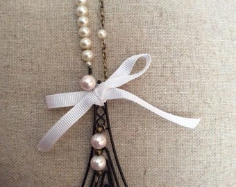 Quirky antique bronze Eiffel Tower and pearl necklace