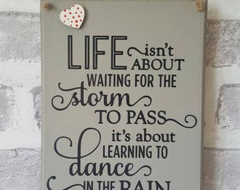 Life isnt about waiting for the storm to pass Hanging Decorative Plaque