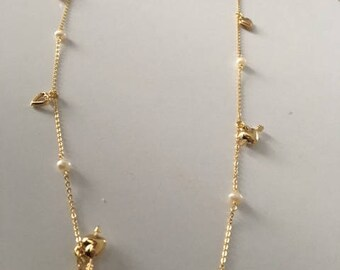 Necklace beads and gold hearts
