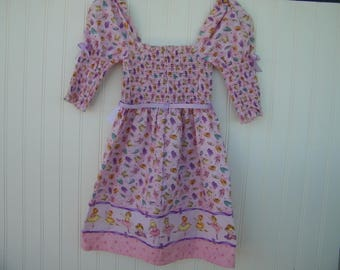 ballerina dress with gathered waist and long sleeves for girls age 4, smocked dress