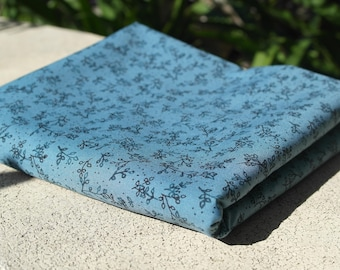 Teal floral fabric good for summer garments