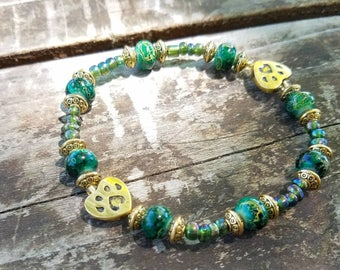 Beautiful green and gold beaded bracelet with pet charms