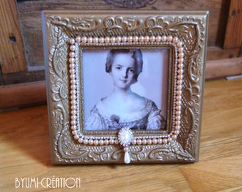 Gold and beaded frame with moldings